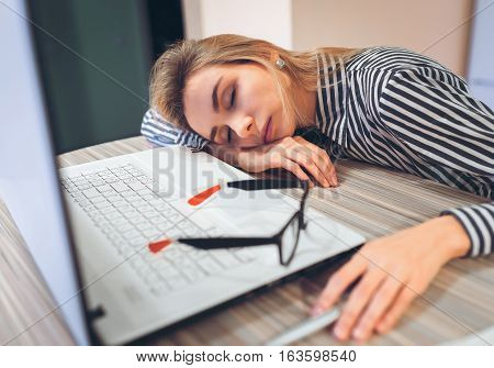 Freelancer Girl Sleeping On The Job At The Table Near The Laptop