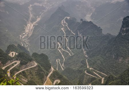 The long and windy 99 turn road going up to the summit of Tianmen shan in the city of Zhangjiajie in Hunan province China.