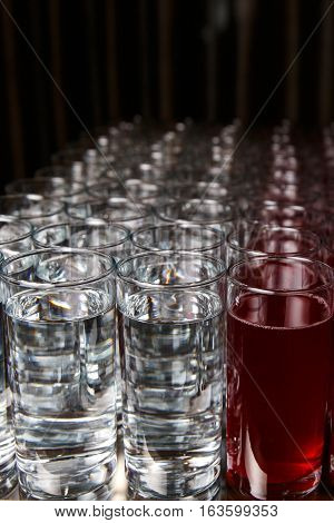 Photography close up of glasses with white and red drink on blank background
