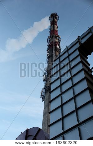 Tall stack of concrete with built additional antennas of mobile telephony