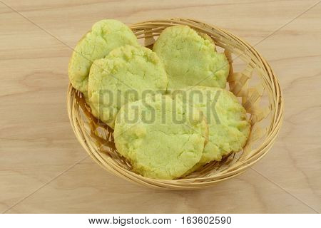 Homemade key lime sugar cookies in wooden basket