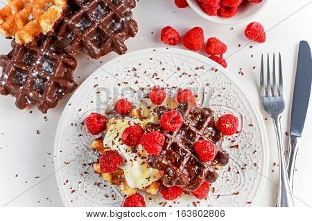 Belgian chocolate waffles with fresh raspberries, whipped cream and honey syrup.