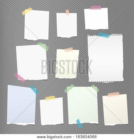 Colorful note, notebook, copybook paper sheets stuck with sticky tape on gray striped pattern.