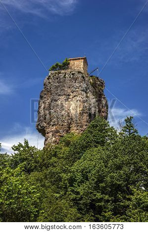 Georgia. Man's monastery near the village of Katskhi . The church and the abbot 's cell on a rocky column of about fifty meters.