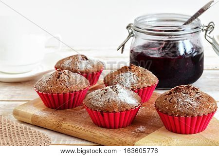 Muffins and jam on the table. Homemade muffins cupcake.