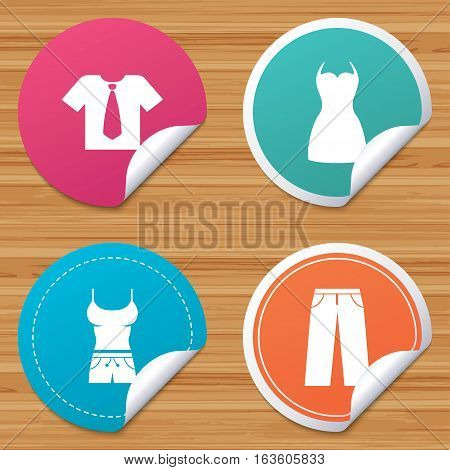 Round stickers or website banners. Clothes icons. T-shirt with business tie and pants signs. Women dress symbol. Circle badges with bended corner. Vector