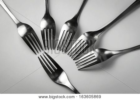 metal forks abstract composition on white background