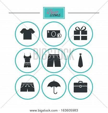 Clothing, accessories icons. T-shirt, business case signs. Umbrella and gift box symbols. Round flat buttons with icons. Vector