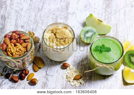 Green smoothie, oat meal and nuts - healthy, vegetarian food