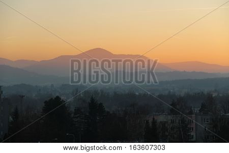 Landscape of Beskydy mountains in the evening with colorful sky