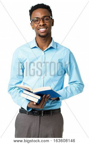 Happy african american college student standing with books in his hands on white background