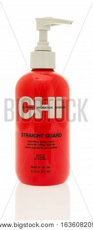 Winneconne WI - 21 December 2016: Bottle of CHI straight guard smooting styling cream on an isolated background.