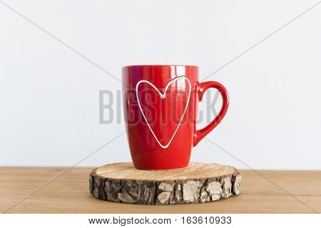 Red Cup Of Tea Or Coffee On The White Background