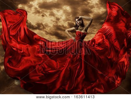 Woman Dancing in Red Dress Fashion Model Dance with Flying Gown Fabric Silk Cloth Flowing Waving on wind