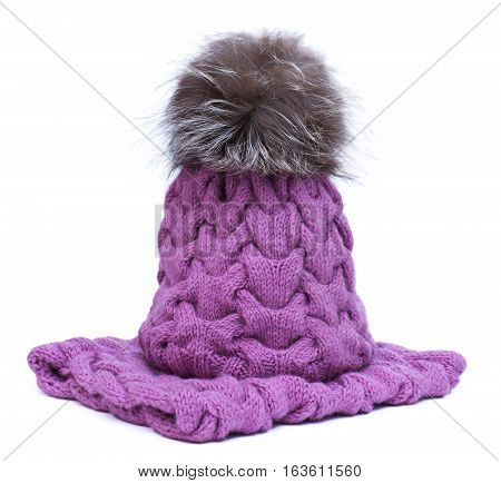 Violet Knitted Woolen Scarf And Hat With Pompom Isolated On White Background.