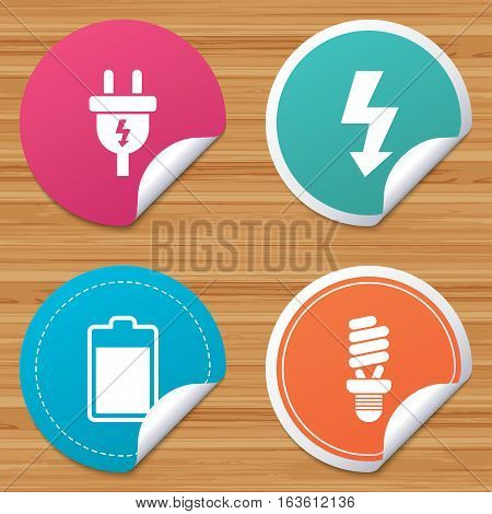 Round stickers or website banners. Electric plug icon. Fluorescent lamp and battery symbols. Low electricity and idea signs. Circle badges with bended corner. Vector