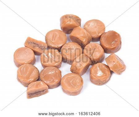 Milk toffee with chocolate cream isolated on white background