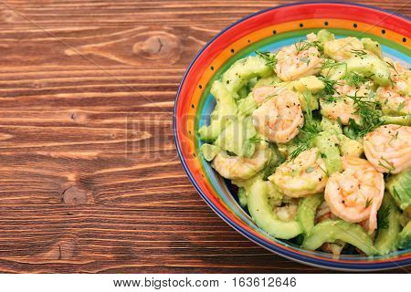 Avocado salad with shrimp and cucumber. Healthy lifestyle and eating concept.