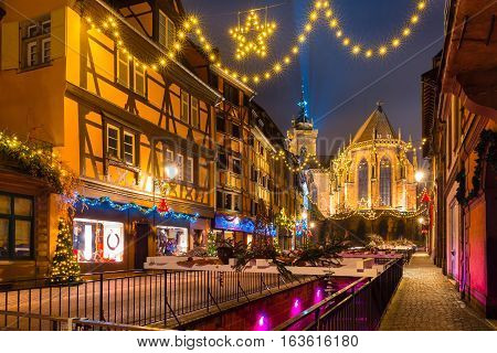 Saint Martin Church in old town of Colmar, decorated and illuminated at christmas time, Alsace, France