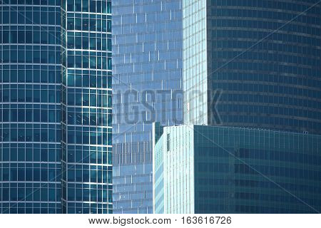 Skyscrapers in modern office business cluster. Horizontal view close up