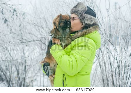 Woman With Dog Pekingese In Winter Park