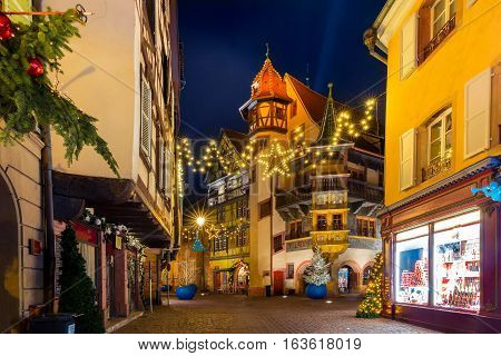 Maison Pfister in old town of Colmar, decorated and illuminated at christmas time, Alsace, France