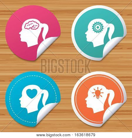 Round stickers or website banners. Head with brain and idea lamp bulb icons. Female woman think symbols. Cogwheel gears signs. Love heart. Circle badges with bended corner. Vector