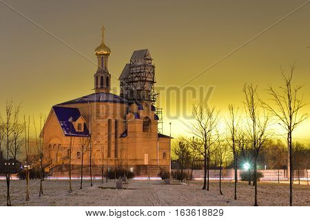 Church in microdistrict Ribatskoe at night on the outskirts of St. Petersburg Russia.