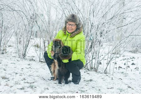 Woman With Dog Pekingese And Cat In Winter Park