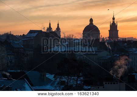 Morning Lviv sunrise. View of the central part of the city and churches: St. Michael's Ukrainian Catholic Church Church of the Holy Communion Korniakt Tower.
