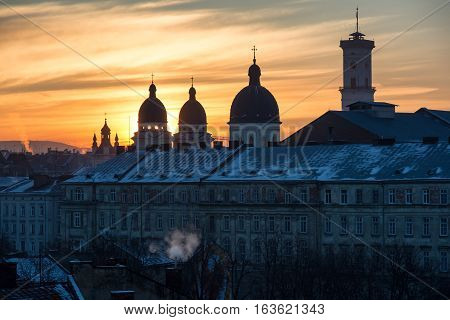 Morning Lviv sunrise. View of the central part of the city and churches: Armenian cathedral Transfiguration Church Lviv city council.