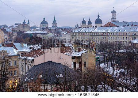 Evening Lviv. View of the central part of the city and churches: St. Michael's Ukrainian Catholic Church Church of the Holy Communion Korniakt Tower Armenian cathedral Transfiguration Church Lviv city council.