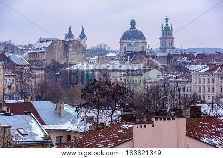 Evening Lviv. View of the central part of the city and churches: St. Michael's Ukrainian Catholic Church Church of the Holy Communion Korniakt Tower Armenian cathedral.