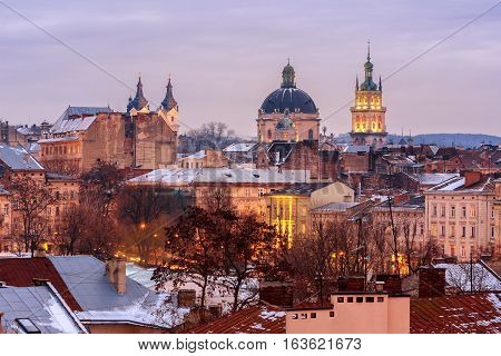 Evening Lviv. View of the central part of the city and churches: St. Michael's Ukrainian Catholic Church Church of the Holy Communion Korniakt Tower.