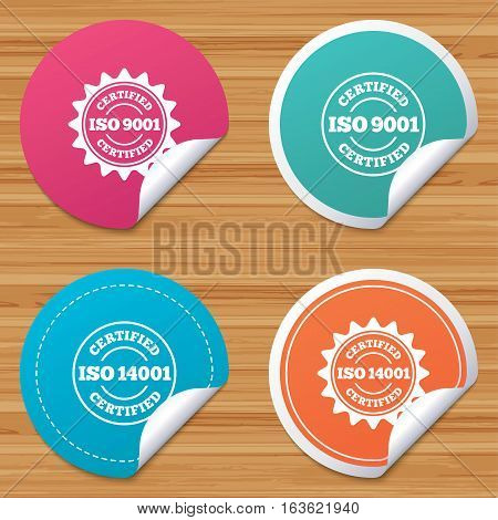 Round stickers or website banners. ISO 9001 and 14001 certified icons. Certification star stamps symbols. Quality standard signs. Circle badges with bended corner. Vector