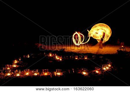 Heart Shape Of Burning Candles On The Ground On A Background Of Fire Show