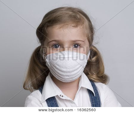 Little girl wearing a particle mask
