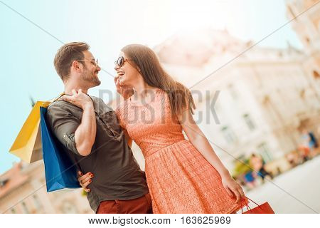 Couple shopping together in the city,having fun