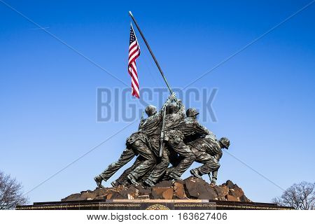 ARLINGTON, VIRGINIA - APRIL 6, 2014: Marine Corps War Memorial, based on the iconic image of the second flag-raising on the island of Iwo Jima during World War II.