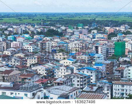 Residential area in downtown Yangon the capital of Myanmar with rice fields in the background