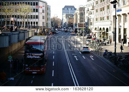 COLOGNE, GERMANY - NOVEMBER 24: A bus for city sightseeing stands in the lively Trank-Lane near the Cologne Cathedral on November 24, 2016 in Cologne.