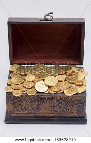 Chocolate coins in a small wooden chest