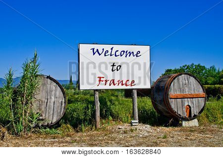 Billboard road surrounded by two wine barrels to welcome the tourists who come to visit France