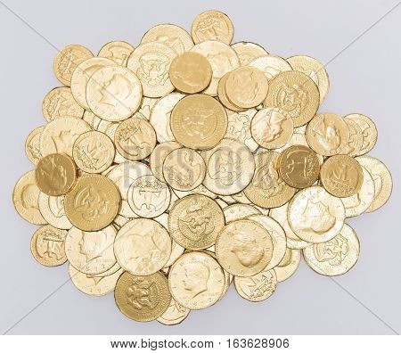Foil wrapped chocolate coins stacked in a pile