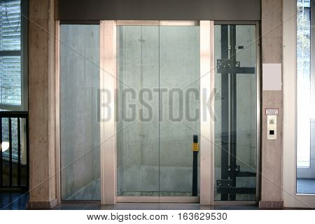 The elevator of a public building at the level zero the ground floor.