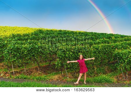 Little girl playing in vineyards, image taken in Lavaux, Canton of Vaud, Switzerland