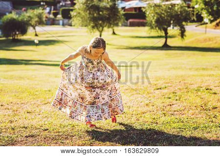 Outdoor portrait of a cute little girl of 8 years, image taken in Italy, Tuscany