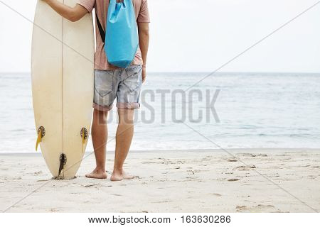 Healthy Lifestyle And Leisure Concept. Rear Cropped View Of Caucasian Tourist Standing Barefooted On