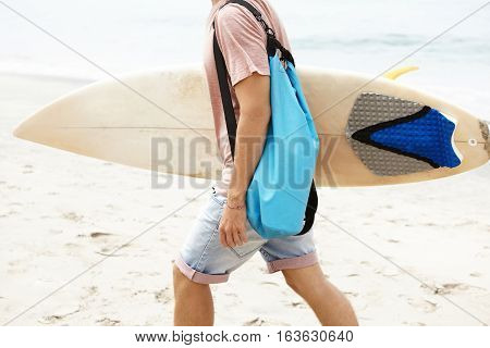 Hobby, Active Lifestyle And Summer Vacations Concept. Cropped Shot Of Young Tourist With Bag Walking