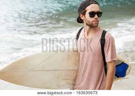 Summer Vacations, People, Travel And Watersports Concept. Fashionable Young Bearded Man Wearing Shad